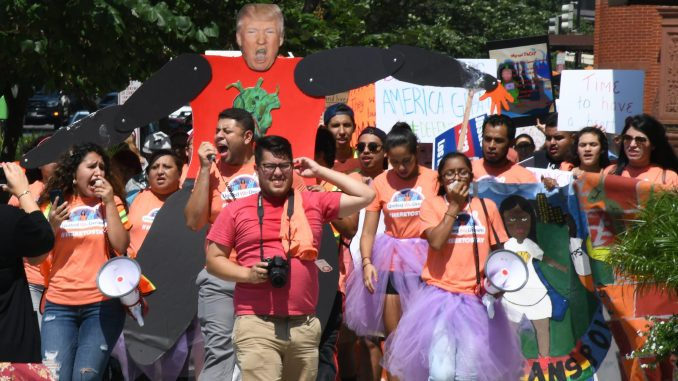Hundreds of demonstrators marched along Pennsylvania Avenue in northwest D.C. on Sept. 5 in protest of President Trump's decision to rescind DACA. (Roy Lewis/The Washington Informer)