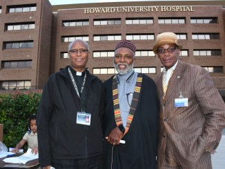 From left: Father Baraki, Imam Johari Abdul-Malik, and Rev. Michael Dickerson offer prayers for those who lost family members from the sickle cell disease during a candlelight vigil on the grounds of the Howard University Hospital in northwest D.C. on Sept. 8. (Roy Lewis/The Washington Informer)