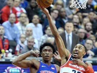 Washington Wizards forward Otto Porter Jr. goes in for a layup past Detroit Pistons forward Stanley Johnson. Porter led all scorers with 28 points to help the Wizards' 115-111 win at Capital One Arena in D.C. on Oct. 20. (John De Freitas/The Washington Informer)