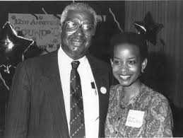 A much younger Denise Rolark Barnes with her father, Dr. Calvin Rolark Sr. (WI photo)