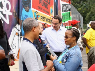 D.C. Council member Vincent Gray (Ward 7) talks with event organizers, speakers, and supporters of the DC Greens Grocery Walk in Southeast on Oct. 14. (E Watson/EDI Photo)