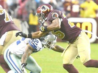 Dallas Cowboys cornerback Orlando Scandrick tackles Washington Redskins running back Chris Thompson during Dallas' 33-19 win at FedEx Field in Landover, Md., on Oct. 29. (John E. De Freitas/The Washington Informer)