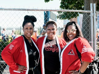 Marva Lewis McKnight (left) and Erica Gentry (right) pose with a fellow sorority sister during Howard University's homecoming celebration in Northwest on Oct. 21. (Michael A. McCoy/The Washington Informer)
