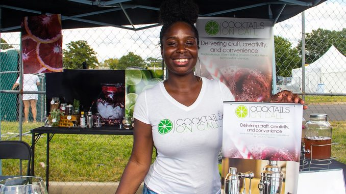 Jazmyne Wade, owner and operator of Cocktails on Call, serves her signature cocktails at the Taste of DC on Oct. 7 at RFK Stadium in southeast D.C. (Shevry Lassiter/The Washington Informer)