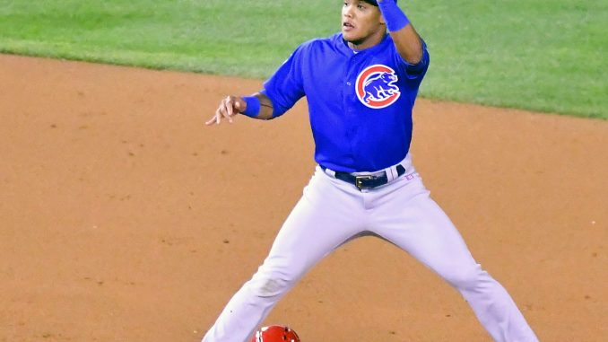Chicago Cubs second baseman Javier Baez awaits the throw as Washington Nationals shortstop Trea Turner steals second base during the Cubs' 9-8 win in Game 5 of the National League Division Series at Nationals Park in Southeast on Oct. 12. (John E. De Freitas/The Washington Informer)