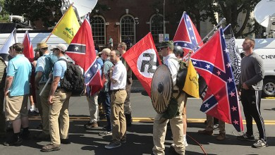 """Alt-right members prepare to enter Emancipation Park holding Nazi, Confederate, and Gadsden """"Don't Tread on Me"""" flags in Charlottesville, Va. (Anthony Crider/Wikimedia Commons)"""
