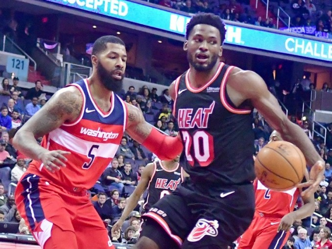 Washington Wizards forward Markieff Morris defends Miami Heat forward Justise Winslow in the third quarter of the Heat's 91-88 victory at Capital One Arena in D.C. on Nov. 17. (John De Freitas/The Washington Informer)