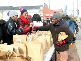 "Residents participate in ""Community Clean Up Day"" in Ward 8 on Nov. 10. (Shevry Lassiter/The Washington Informer)"