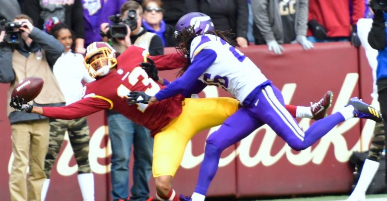 Washington Redskins wide receiver Maurice Harris lays out to haul in a one-handed touchdown while defended by Minnesota Vikings cornerback Trae Waynes in the first quarter of the Vikings' 38-30 win at FedEx Field in Landover, Md., on Nov. 12. (John E. De Freitas/The Washington Informer)