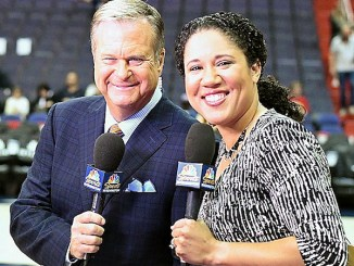 Kara Lawson (right), seen here with longtime broadcaster Steve Buckhantz before a recent Washington Wizards game, replaced Phil Chenier, who worked as analyst for 33 years. (John De Freitas/The Washington Informer)