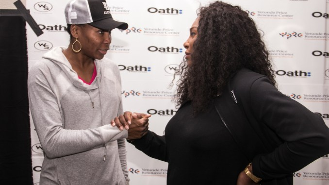 """Tennis legends and sisters Venus (left) and Serena Williams host """"A Family Affair"""" event at the Southeast Tennis and Learning Center in D.C. on Dec. 4. (Shevry Lassiter/The Washington Informer)"""
