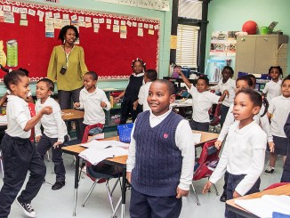 Kindergarten teacher Briona Campbell uses the art of singing to help young students learn the parts of a sentence. (Shevry Lassiter/The Washington Informer)