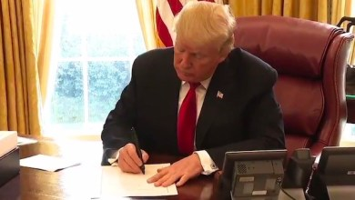President Donald Trump signs a $1.5 trillion tax-cut bill into law at the White House on Dec. 22.