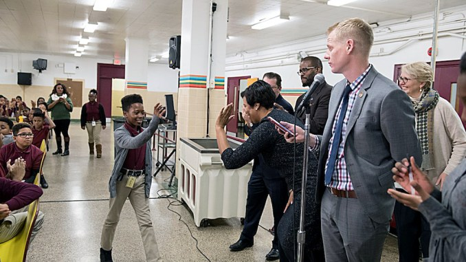 City officials celebrate Jefferson Middle School Academy's success in family engagement on Jan. 3. (Courtesy of JATrojans)