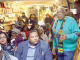 "A. Peter Bailey (far right) moves to address the audience during the screening of ""Malcolm X: An Overwhelming Influence on America's Black Power Movement"" at Sankofa Video Books & Cafe in northwest D.C. on Jan. 3. (E Watson/EDI Photo)"