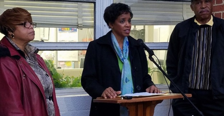 Donna Edwards, candidate for Prince George's County executive, speaks during a Feb. 22 press conference outside the school administration building in Upper Marlboro as Phyllis Wright (left), parent of two county students, and Bob Ross, president of the county's NAACP chapter, look on. (William J. Ford/The Washington Informer)