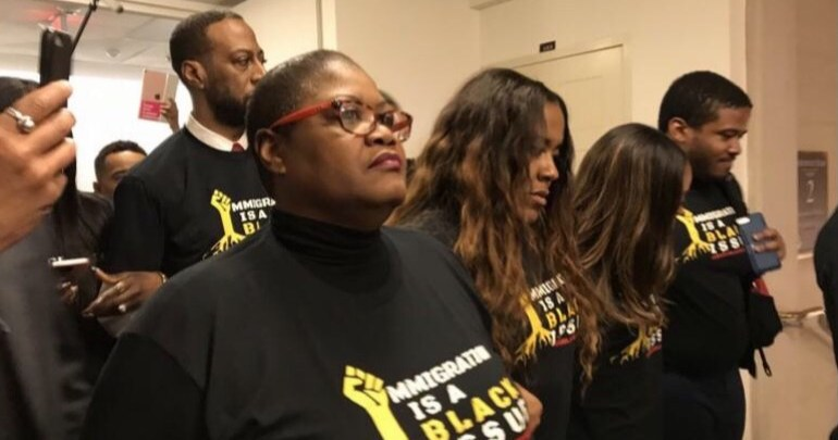 From left: Demonstrators Melanie Campbell, YoNasDa Lonewolf, Tamika Mallory and Mysonne Linen, along with Rev. Tony Lee (in rear) head to the Capitol Hill office of House Speaker Paul Ryan to stage a protest of the nation's immigration policies on Feb. 27. (Courtesy of National Coalition on Black Civic Participation)