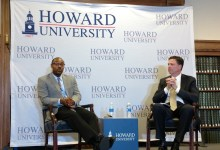 Former FBI Director James Comey (right) and Howard University associate law professor Justin Hansford participate in the university's lecture series on Howard's northwest D.C. campus on Feb. 13. (Brenda C. Siler/The Washington Informer)