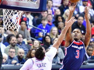 Washington Wizards guard Bradley Beal shoots over Philadelphia 76ers forward Dario Saric during the Wizards' 109-94 win at Capital One Arena in D.C. on Feb. 25. (John De Freitas/The Washington Informer)