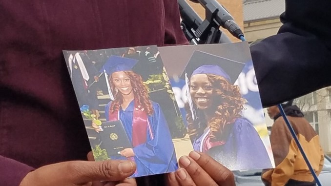 Lydia Banks holds two high school graduation pictures of her daughter, Allyssa, during a Feb. 1 press conference outside the Prince George's County Courthouse in Upper Marlboro, where authorities announced three men had been charged with Allyssa's fatal shooting in 2016. (William J. Ford/The Washington Informer)