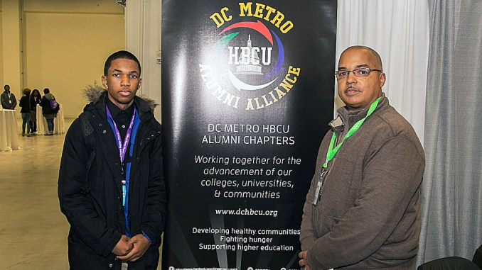Jelani Jackson, a junior at Bishop McNamara High School in Forestville, Maryland, and his father, John Jackson, an engineer and Howard University graduate (Mark Mahoney/The Washington Informer)