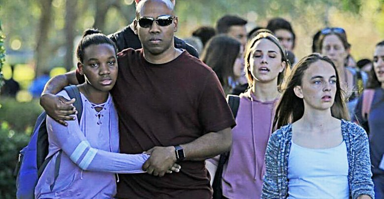 Students and parents leave at Marjory Stoneman Douglas High School in Parkland, Florida, after a gunman opened fire on the campus on Feb. 14. (Al Diaz/Miami Herald)