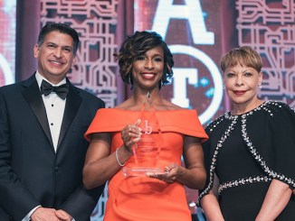 Jose Tomas, the senior vice president of global human resources and the executive vice president for Lockheed Martin (Ret.) (left) and Linda Gooden from the General Motors Board of Directors (right) present Alicia Boler Davis, the executive vice president global manufacturing for General Motors with the 2018 Black Engineer of the Year Award. (General Motors)