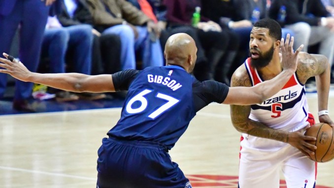 Washington Wizards power forward Markieff Morris (5) faces up against Minnesota Timberwolves power forward Taj Gibson in the first quarter of Minnesota's 116-111 win at Capital One Arena in D.C. on March 13. (John De Freitas/The Washington Informer)