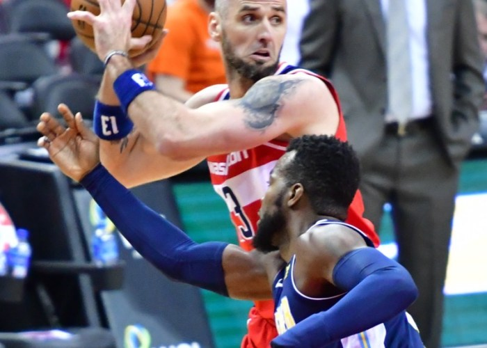 Washington Wizards center Marcin Gortat fends off a Denver Nuggets defender during the Nuggets' 108-100 win at Capital One Arena in D.C. on March 23. (John De Freitas/The Washington Informer)