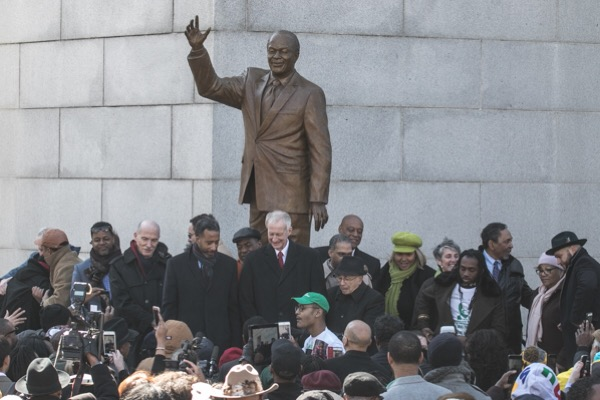 Current and past city council members stand in front of the new statue of Marion Barry outside the John H. Wilson Building in northwest D.C. during an unveiling ceremony on March 2. (Shevry Lassiter/The Washington Informer)