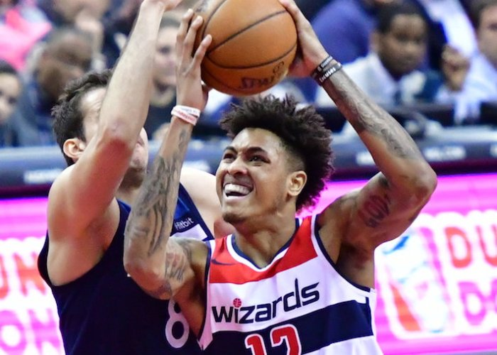 Washington Wizards forward Kelly Oubre Jr. drives against Minnesota Timberwolves forward Nemanja Bjelica during Minnesota's 116-111 win at Capital One Arena in D.C. on March 13. (John E. De Freitas/The Washington Informer)