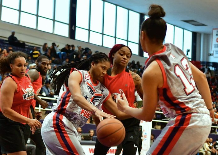 The Washington Fusion's Tierra Ruffin-Pratt drives to the basket during the Fusion's 118-91 win over the Chicago Vikings in an exhibition game for the new Global Mixed Gender Basketball League at Howard University's Burr Gymnasium in D.C. on March 24. (John E. De Freitas/The Washington Informer)