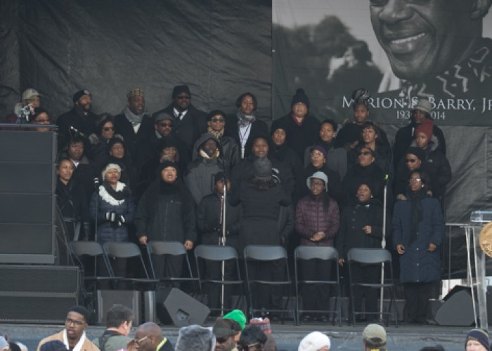 The Washington Performing Arts gospel choir singing in the program for the Marion Barry Jr. statue unveiling on Saturday, March 3 at the John Wilson Building in Northwest. (Shevry Lassiter/The Washington Informer)
