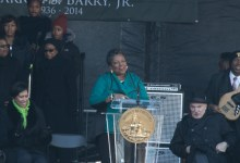 Cora Masters Barry speaks during the Marion Barry Jr. statue unveiling program held on Pennsylvania Avenue in front of the John Wilson District Building in Northwest on Saturday, March 3. (Shevry Lassiter/The Washington Informer)