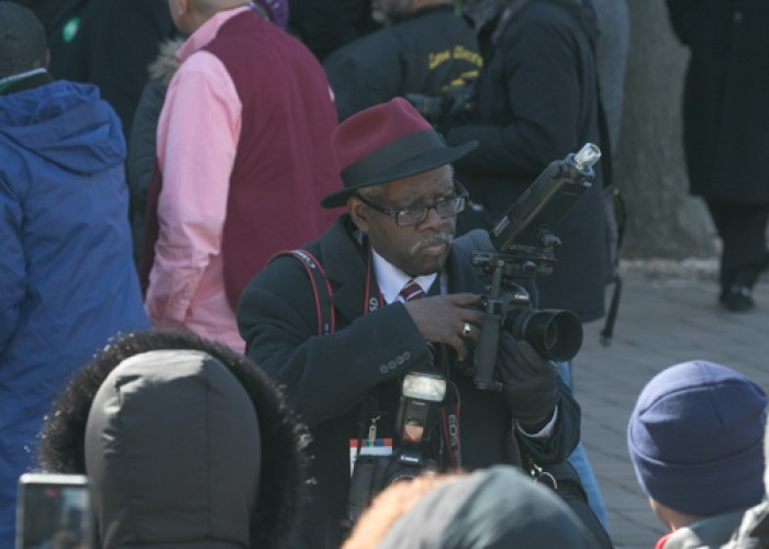 Historical photographer Don Baker captures the historical moment of the Marion Barry Jr. statue unveiling held on Pennsylvania Avenue in front of the John Wilson District Building in Northwest on Saturday, March 3. (Shevry Lassiter/The Washington Informer)