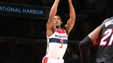 Washington Wizards guard Bradley Beal shoots a jumper over Miami Heat center Hassan Whiteside during the Wizards' 117-113 overtime win at Capital One Arena in D.C. on March 6. (Courtesy of the Wizards via Twitter)