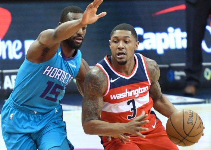Washington Wizards guard Bradley Beal drives against Charlotte Hornets guard Kemba Walker during the Wizards' 107-93 win in D.C. on March 31. (John De Freitas/The Washington Informer)