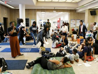 Howard University students occupy the Mordecai Wyatt Johnson Administrative Building on the university's northwest D.C. campus, demanding the immediate resignation of President Wayne A.I. Frederick. (Roy Lewis/The Washington Informer)