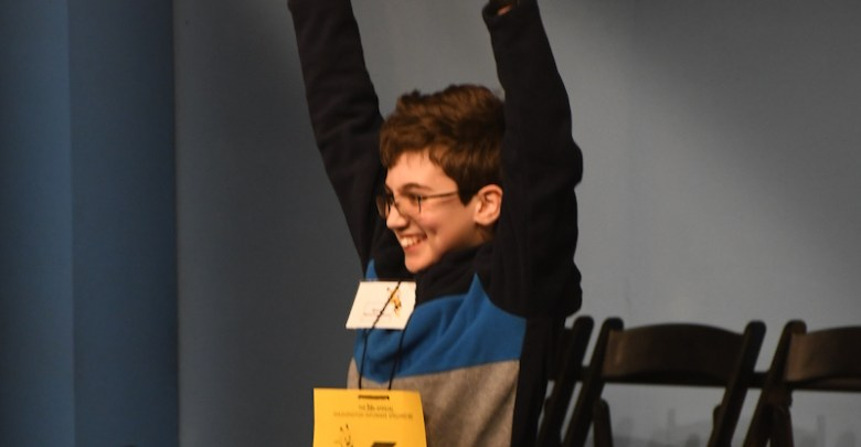 Simon Kirschenbaum, a seventh-grader at Deal Middle School in Northwest, celebrates after winning The Washington Informer's 36th Annual Spelling Bee. (Roy Lewis/The Washington Informer)