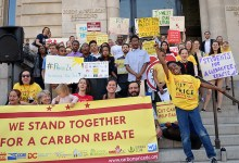 Student advocates of cutting carbon pollution rally at the John A. Wilson Building in northwest D.C. in favor of a carbon fee and rebate program. (Courtesy of Put a Price on It)