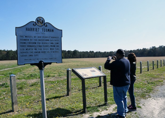 Visitors stop along the Tubman Trail at a marker of the Broadus Plantation where Tubman was enslaved and learned the skills that were vital in making her an effective conductor of the Underground Railroad using the North Star as a guide to freedom. (Roy Lewis/The Washington Informer)