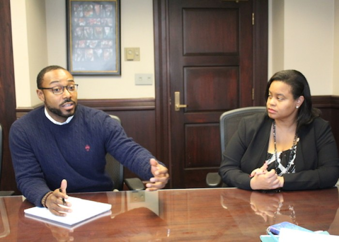 Justin Hansford, executive director of the Howard University School of Law's Thurgood Marshall Civil Rights Center speaks as Danielle Holley-Walker, dean of the Howard law school, listens. (Brigette White/The Washington Informer)