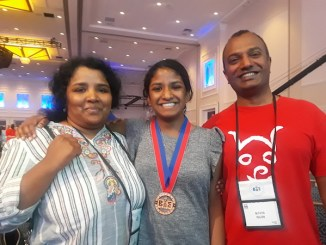 Nilla Rajan, flanked by parents Nithya and Karthika Rajan, is one of 42 finalists in the 2018 Scripps National Spelling Bee. (Dorothy Rowley/The Washington Informer)