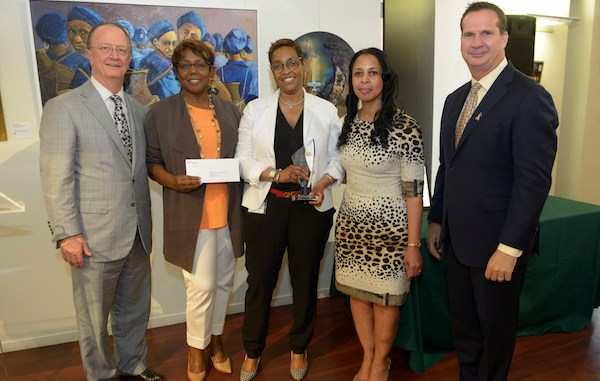 "Moneka Cunningham (center), Pepco external affairs manager, is recognized for her work with the Foundation for the Advancement of Music and Education at Exelon's ""Energy for the Community Volunteer"" awards luncheon on May 23. Pictured are (from left) Exelon Senior Executive Vice President and Chief Strategy Officer William Von Hoene, FAME founder and Executive Director A. Toni Lewis, Cunningham, Pepco Region President Donna Cooper, Pepco Holdings Senior Vice President and COO Tyler Anthony. (Courtesy of Pepco/Exelon)"