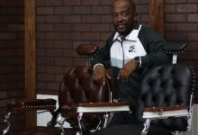 Sid Tutani shows off antique barber chairs. (Courtesy of Urban News Service)