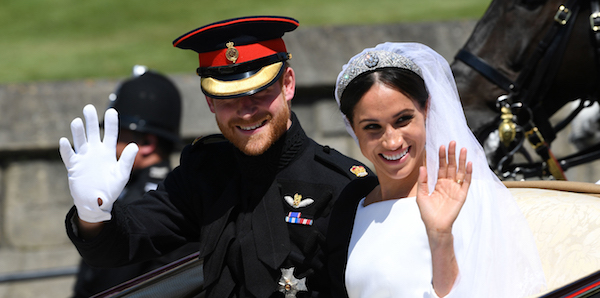 Prince Harry and Meghan Markle ride in an Ascot Landau after their wedding ceremony at St. George's Chapel in Windsor Castle. (Courtesy of royal.uk)