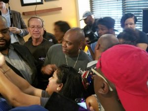 Comedian Dave Chappelle (center) takes photos with supporters of Maryland gubernatorial candidate Ben Jealous during a June 8 campaign rally at the Old Towne Inn in Largo. (William J. Ford/The Washington Informer)