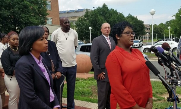 NeShanna Turner, whose sister, NeShante Davis, and Davis' 2-year-old daughter, Chloe Davis-Green, were both fatally shot by Daron Boswell-Johnson in February 2016, speaks briefly to reporters outside the Prince George's County Circuit Court in Upper Marlboro on June 21 after a judge sentenced Boswell-Johnson to life in prison. (William J. Ford/The Washington Informer)