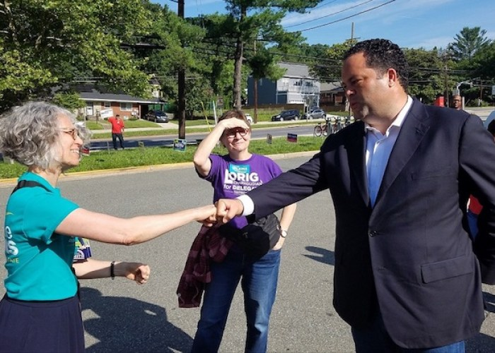 Former NAACP President Ben Jealous (right), who is running for Maryland governor, fist-bumps Amy Wasserstrom outside the Takoma Park Community Center in Montgomery County during the Maryland primary election on June 26. (William J. Ford/The Washington Informer)