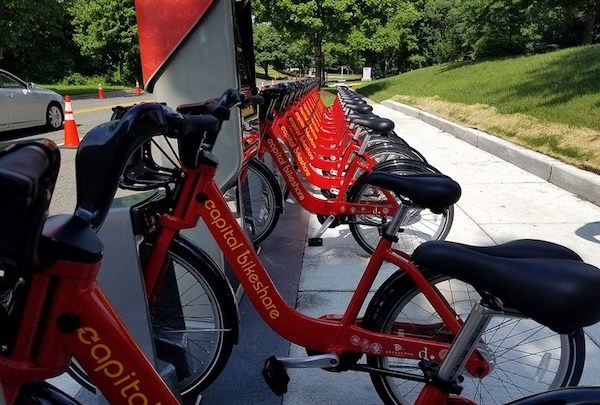 Bikes line a Capital Bikeshare station near the Wayne K. Curry Administration Building in Largo, one of five stations currently in operation in Prince George's County. (William J. Ford/The Washington Informer)